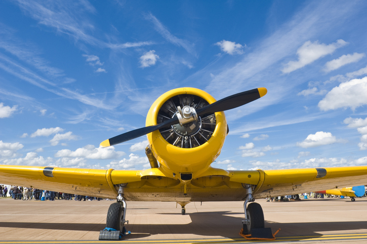 yellow propeller airplane