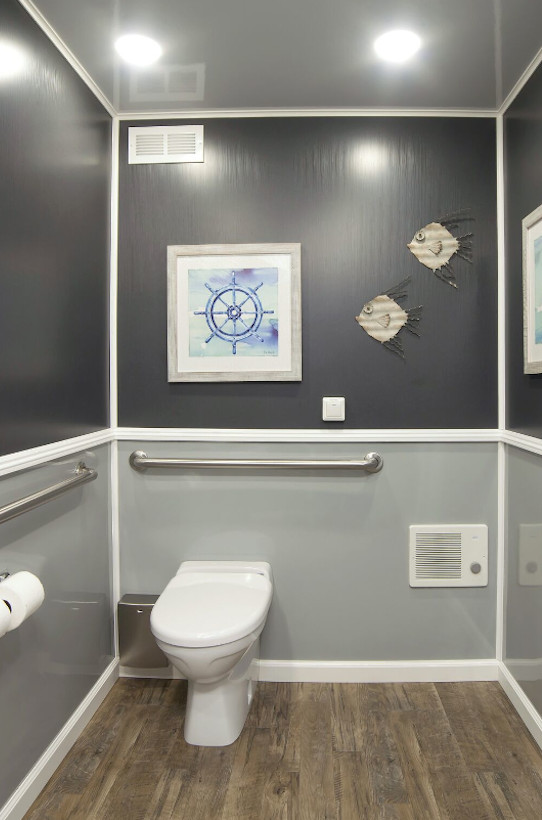 restroom with a picture on the wall