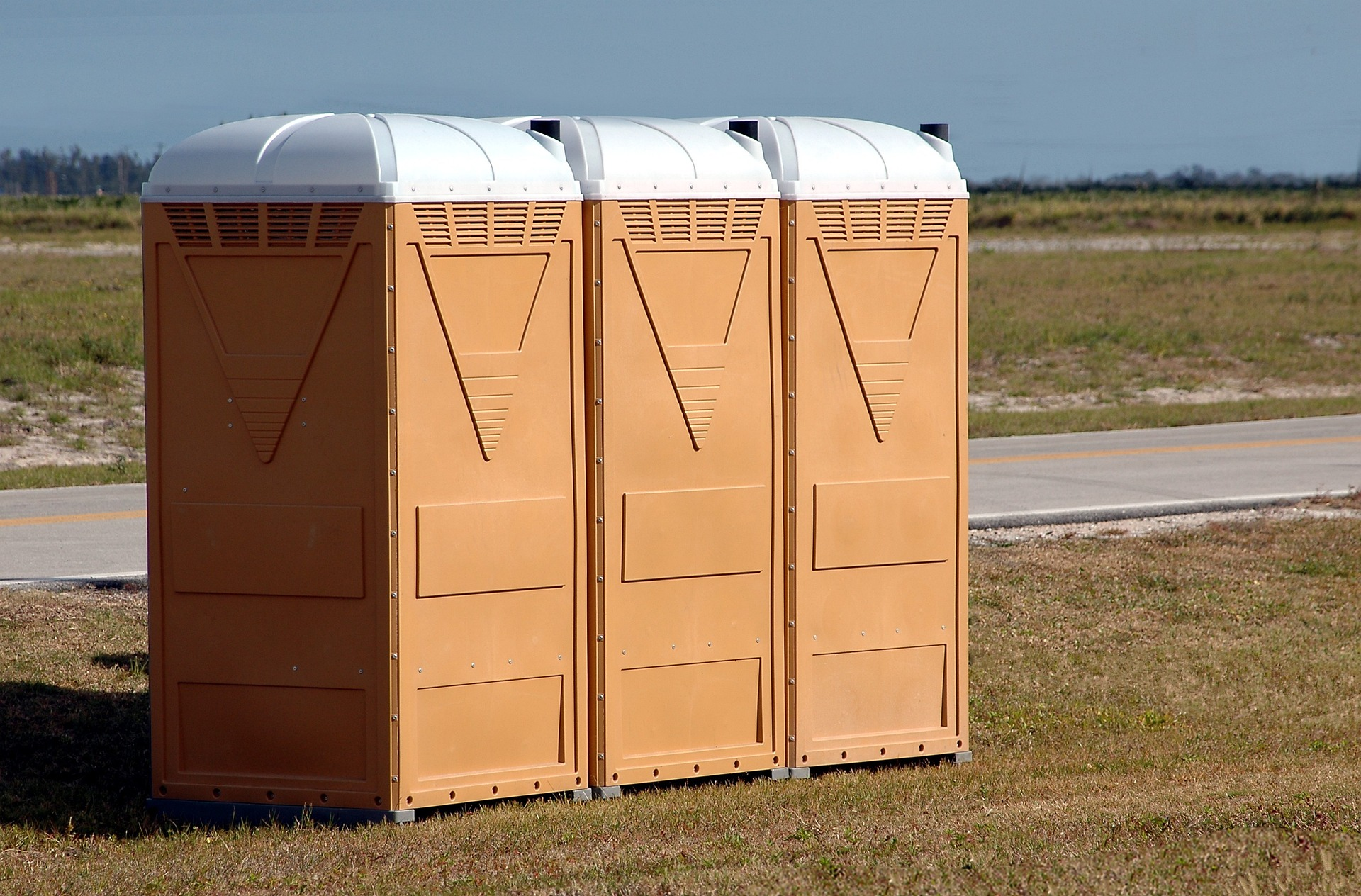 portable restrooms in a field